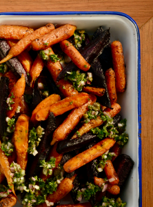 Emanmel baking try with roasted carrots with carrot top salsa verde